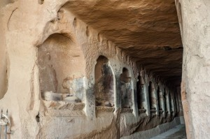 Ruins of grottoes carved into the mountains at Zhangye