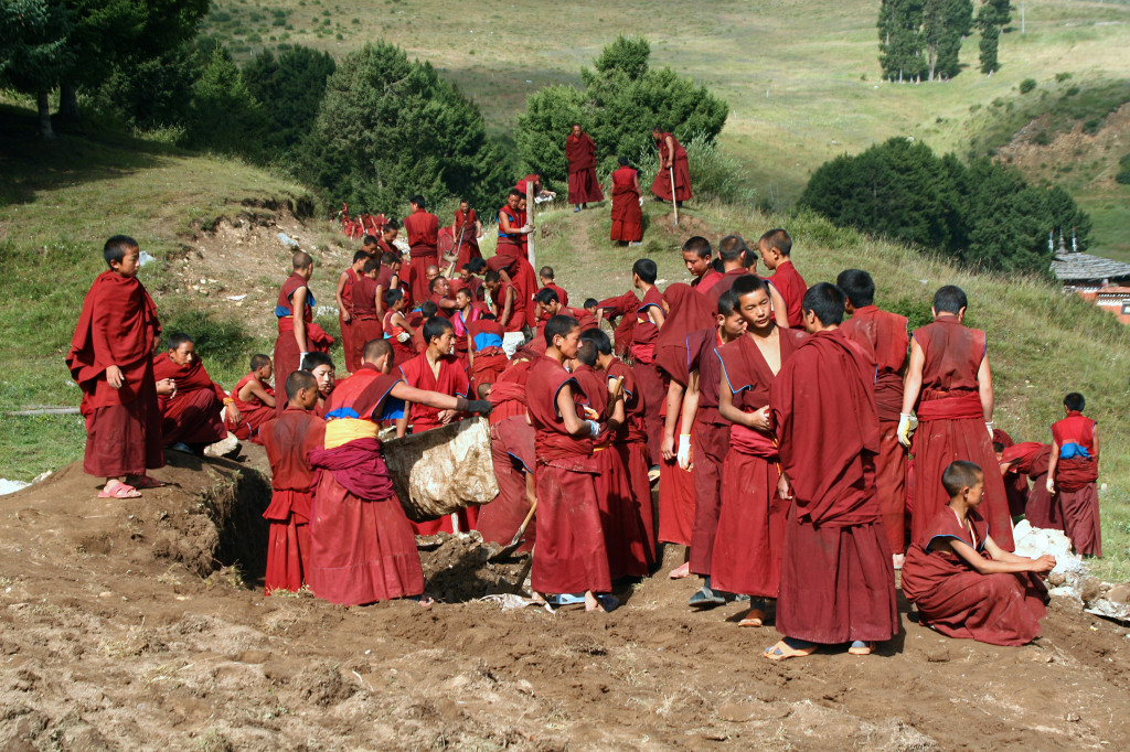Xiahe Monks repair water supply system near Labrang Monestary, Gansu