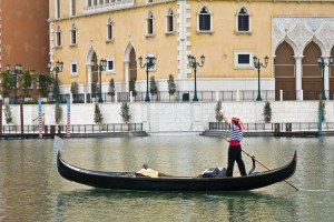 shutterstock_11799325 Macau, A gondalier waves as he negotiates the lake at the venetian in macau