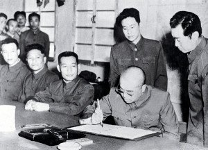 General Peng Dehuai signs armistice ending the Korean War